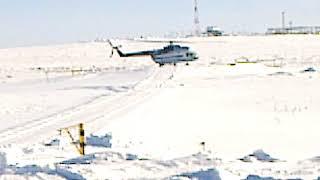 Взлет вертолета на Крайнем Севере