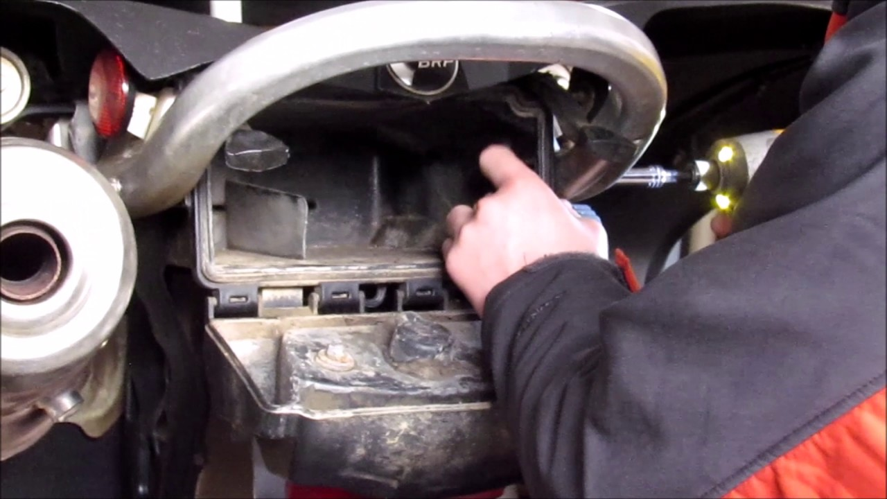 Can am renegade - How to access battery - YouTube