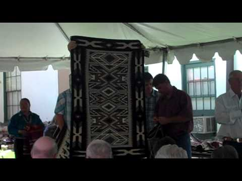 Auctioneer at 20th Annual Navajo Rug Auction, Santa Fe, New Mexico