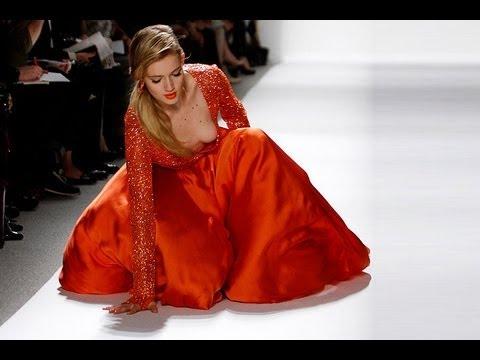 Model falls down during Dennis Basso Fall/Winter 2012 RTW fashion show