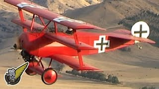 This is an air-to-air video of a Fokker Dr.1 Triplane, in the colou...