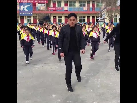 Pupils shuffle dance with principal during break in Shanxi, China