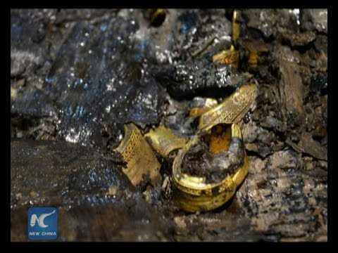 Gold, jade items found in 2,000-year-old Chinese coffin