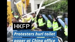 Demonstrators throw toilet paper at China Liaison Office in protest of Carrie Lam's 'appointment'