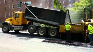 Mack Granite Dumptruck loading Cat Ap-1000P paver
