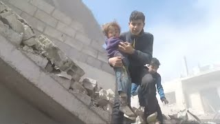 Bodycam footage shows children being rescued from rubble in eastern Ghouta, Syria thumbnail