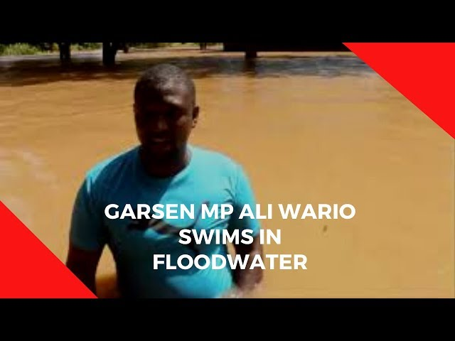 Watch Garsen MP Ali Wario swim in floodwater as he tours Bandi village