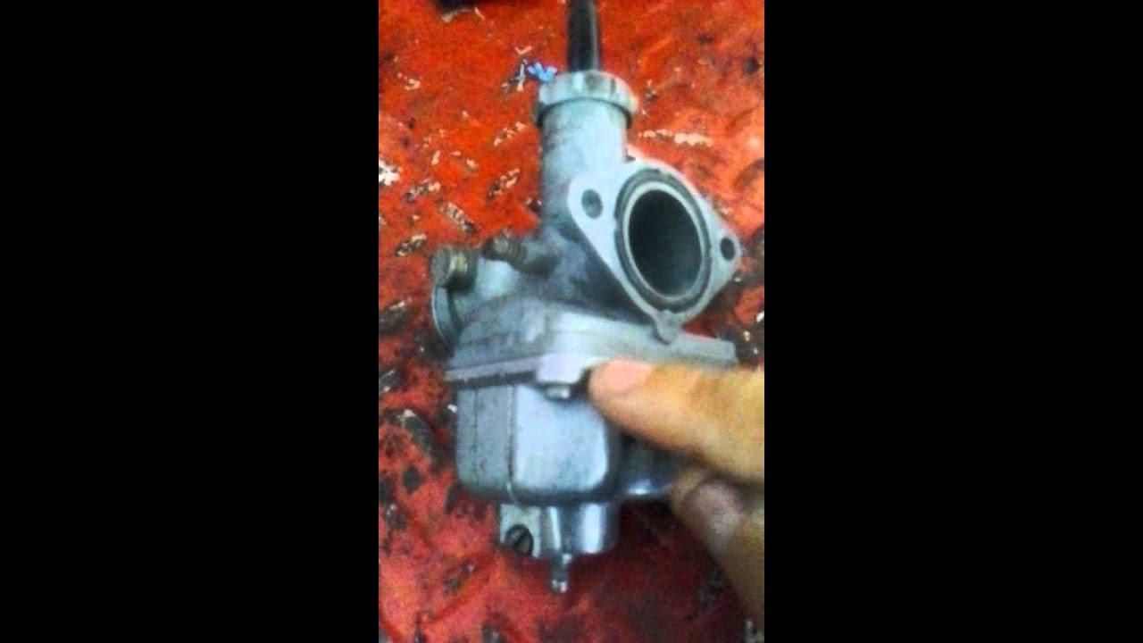 Show tillotson carburetor model X float level setting - Fixya
