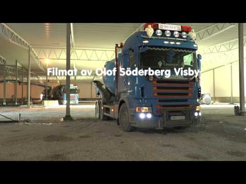 Scania trucks transport the concrete to a large building  Feb 2017