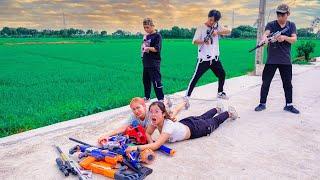AVG Nerf War : Couple Girl SEAL X Warriors Nerf Guns Fight Bad Team Trace the enemy