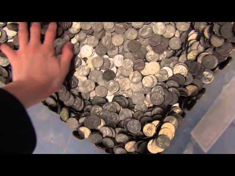 Guy deposits 200 pounds of coins at a bank