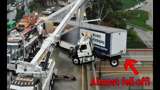 Big rig crashes and is left dangling off freeway bridge in Los Angeles! thumbnail
