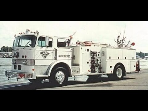 Rochester New York Fireman's Parade going down Lake Ave. to Charlotte.  1992