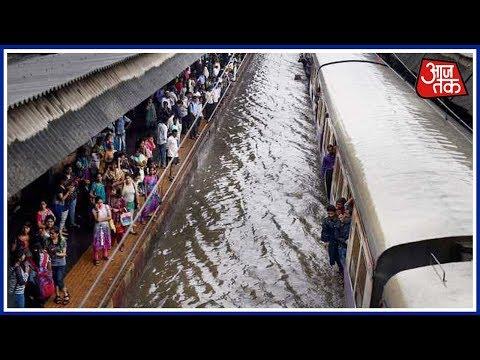 Live: Heavy Rains Lash Andheri, Thane; Railway Services Partially Resume
