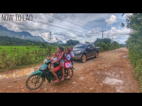 Mountain Villages of Laos - Lao Children Playing in the Rain - Driving through a Torrential Downpour