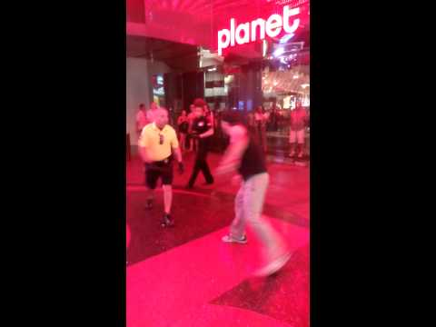 Only in Vegas...dude fight security until he gets tackled by a football team of securities!!!!
