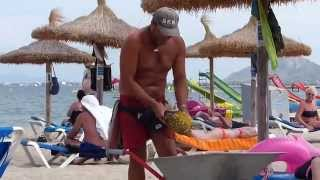 Cheeky Fresh Fruit Seller - Puerto Pollensa beach, Majorca. August 2014