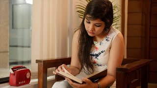 Indian girl reading a book / novel in a relaxed mood