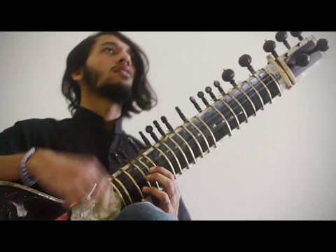 Musician playing Animals as Leaders sitar cover