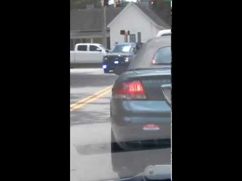 Monroe Ga Police Dept. Stop traffic for flag