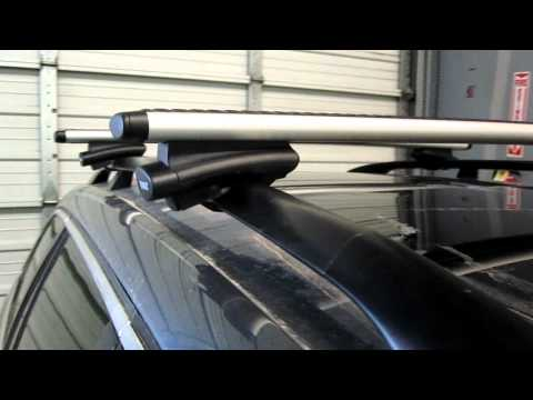 Volkswagen Jetta Sportswagen with Thule 450R AeroBlade Roof Rack by Rack Outfitters