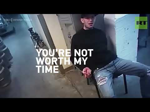 Handcuffed suspect spits on Denver cop & gets knocked out