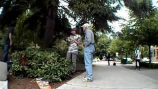 Old man vs. Skaters on Go Skate Day.