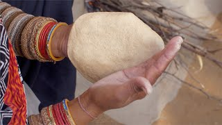 Close shot an Indian woman making chapati with hands