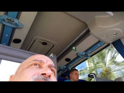 Tourist Guide Prof. Norman Khalaf guiding inside the bus and speaking about Dubai sky scrapers