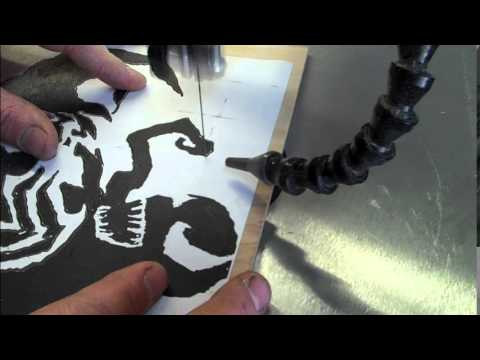 2 scroll saw portraits from one cut
