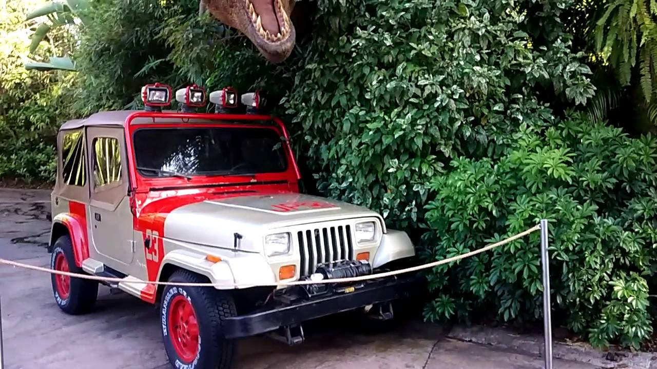 jurassic park jeep being showcased as a tee rex is about. Black Bedroom Furniture Sets. Home Design Ideas