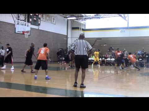 Former NFL Player Walter Young tries to block REAA Basketball League Legend Mario A. Reed