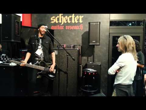 Dug Pinnick at the Schecter booth with Rex Brown checking out his amp