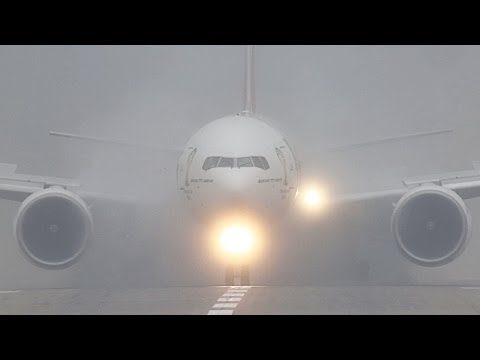 Wet Runway!! Amazing Ghost Plane Arrival. Emirates Boeing 777 Arrival during intense fog (HD)