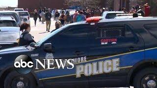 Baltimore high school staff member shot in school