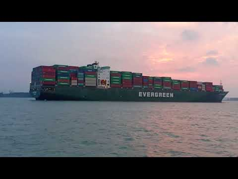 massive marine Msc & Evergreen container ship meet each other in port of tanjung pelepas||
