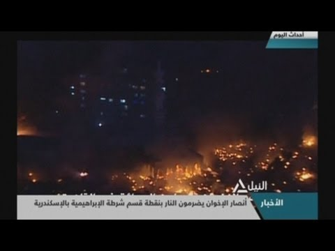 Night time aerials show Egyptian capital Cairo burning after day of bloodshed
