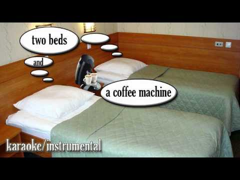 two beds and a coffee machine testo 1