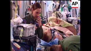 An inside look at getting a C-17 military transport jet ready to take war wounded from Germany back