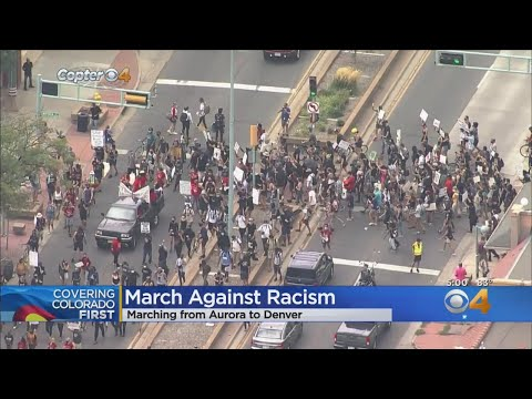 Demonstrators March From Aurora To Denver In The Name Of Racial Justice