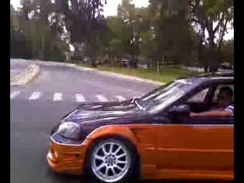 Riced Out Honda Civic Gets Owned By A Tribute Youtube