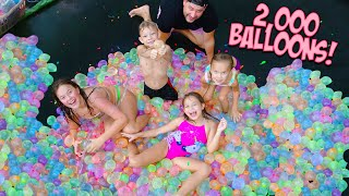 WE FILL OUR TRAMPOLINE WITH 2,000 WATER BALLOONS!!