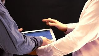 Tablet Sharing Among Work Colleagues  Stock Video
