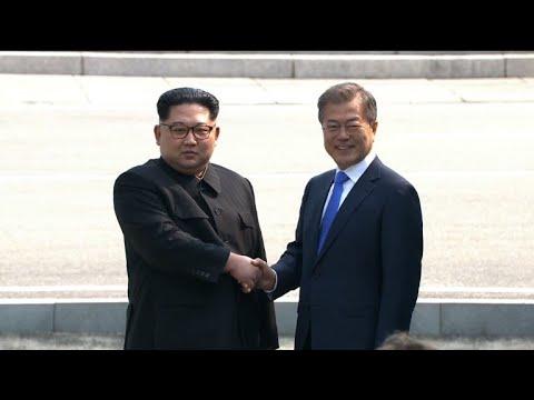 Moon and Kim shake hands before historic summit