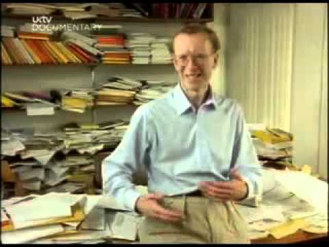 Andrew Wiles in his office admidst piles of papers and files.