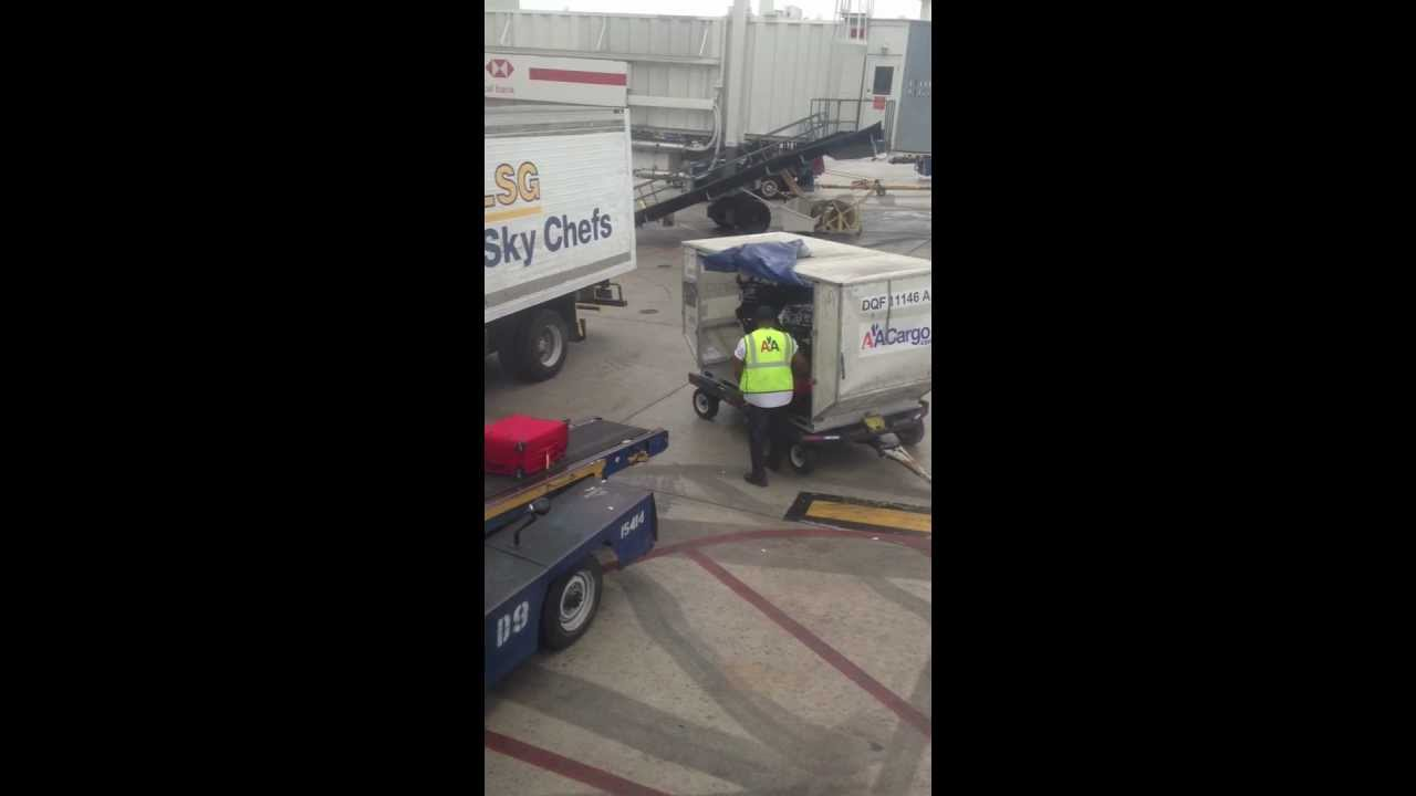 Guy throwing passengers luggage at Miami International Airport.  He should be fired!!!!