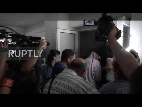 Cyprus: UK woman suspected of false gang rape claim arrives at court