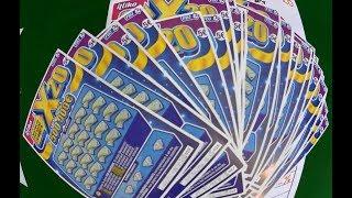 Grattage d'un carnet X20 - Jeux à gratter FDJ ILLIKO, carnet à 150€.
