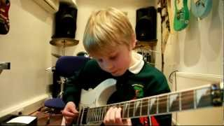 8 year old guitarist alex plays holiday by green day