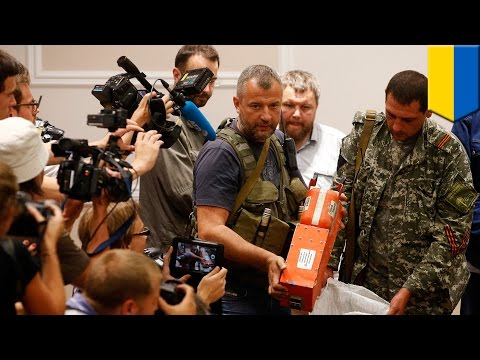 Malaysia Airlines MH17 black boxes show crash caused by rocket shrapnel